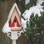 This cheerful birdhouse was handmade specifically for our yard by a wonderful local folk artist.