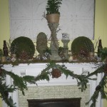 Detail of the living room mantle.  Full of my craft projects with handmade pinecone accents and twine vases.